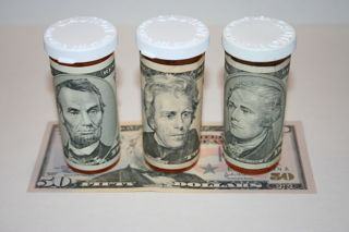 Prescription Drug Bottles Wrapped With Money