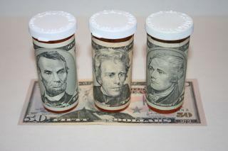 Prescription Drug Bottles Wrapped With Money