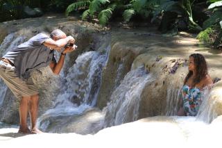 Jamaica Photographer Taking Photo of Women in Waterfall