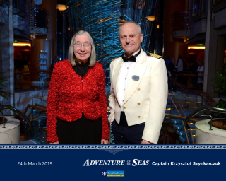 Cruise Passenger With Captain on Royal Caribbean Cruise Line Ship