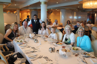 Family on Cruise Ship With Waiter