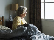 Senior Citizen Looking Out the Window in a Nursing Home