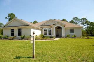 Home Large White With For Sale Sign and Green Grass
