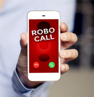 Robocall Sign on a Cell Phone Being Held Up By a Hand