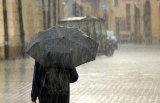 Rain on Man With a Black  Umbrella