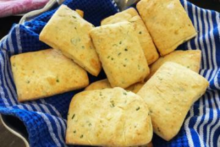 Parmesan Chive Biscuits on a Cloth in a Dish