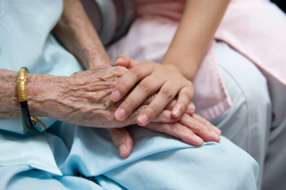 Elderly Woman's Hands With a Younger Woman's Hands