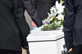 Coffin White Six Men in Black Suits Carrying Flowers on Top