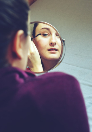 Makeup-Being Applied to Woman Looking in a Mirror 932089_640